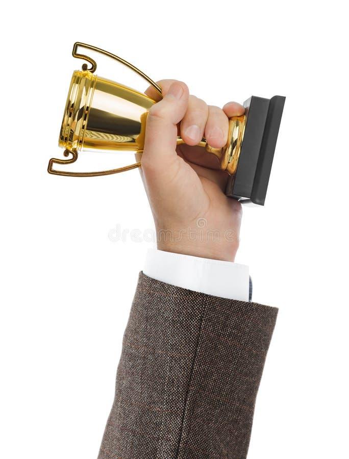 Tasse d'or de trophée à disposition photo stock