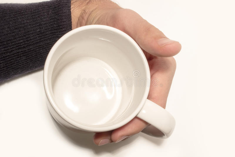 Tasse dans ma main photos stock