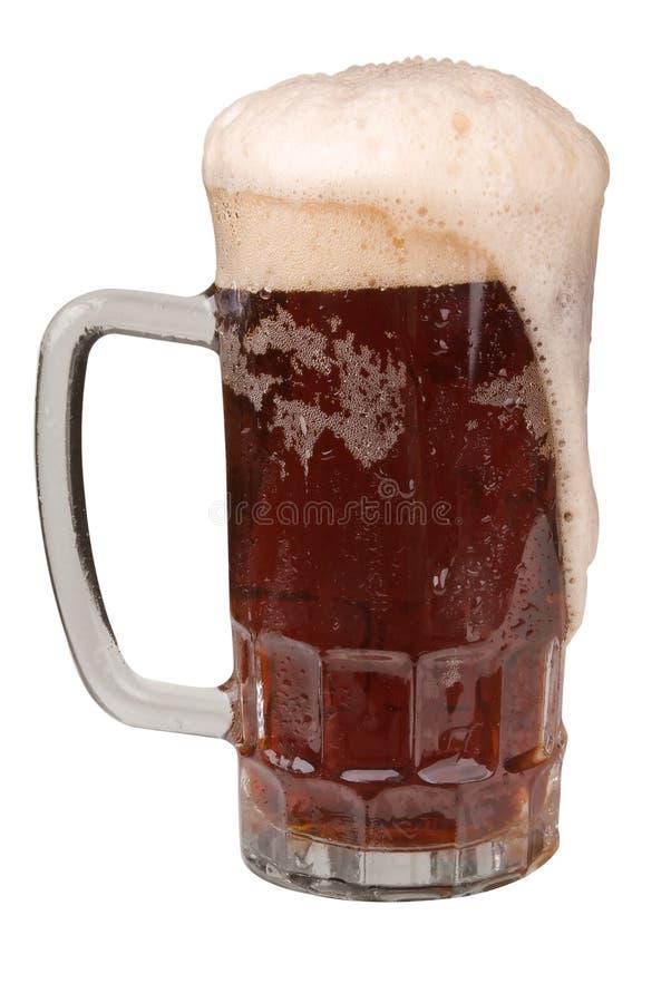 Tasse de bière anglaise avec une tête écumeuse photographie stock libre de droits