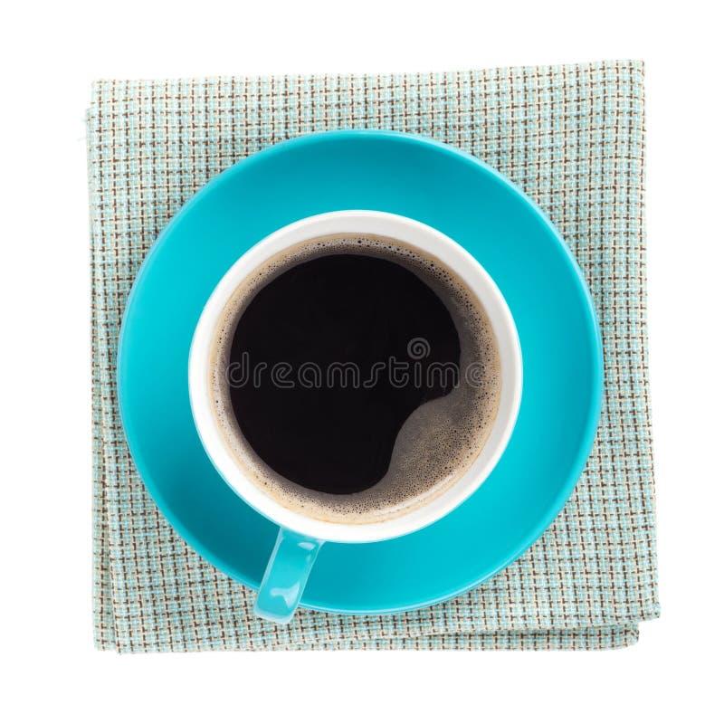 Tasse de café bleue au-dessus de serviette de cuisine image stock