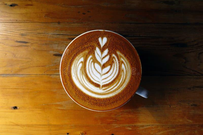Tasse de café d'art de latte photo stock