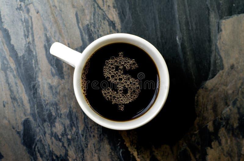 Tasse de café : symbole dollar photographie stock