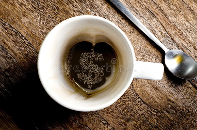Tasse de café - symbole dollar conceptuel photo libre de droits