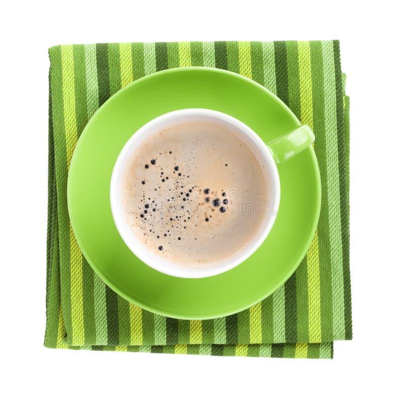 Tasse de café verte au-dessus de serviette de cuisine image libre de droits