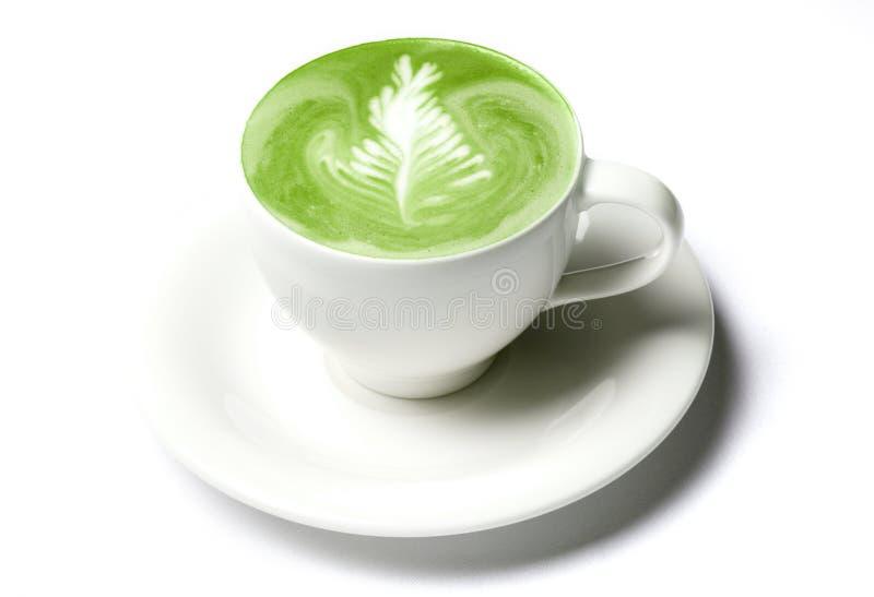 Tasse de latte de thé vert de matcha au-dessus de blanc photo stock