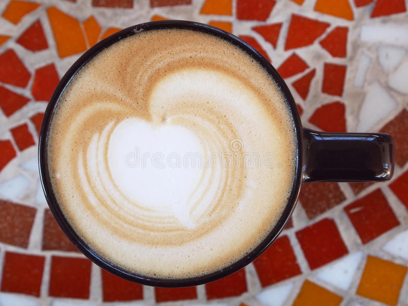 Tasse de lattle photos stock