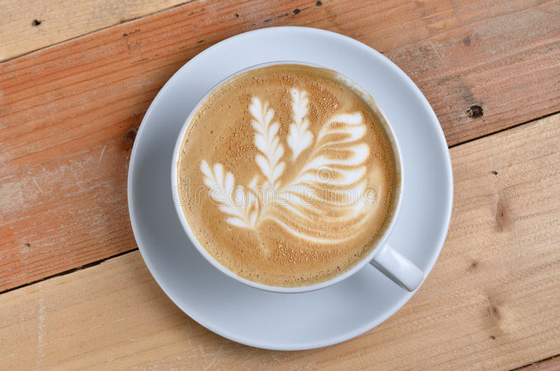 Tasse de lattle image stock