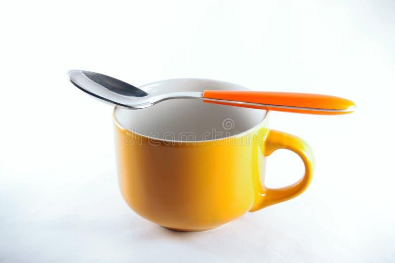 Tasse de petit déjeuner avec la cuillère photographie stock libre de droits