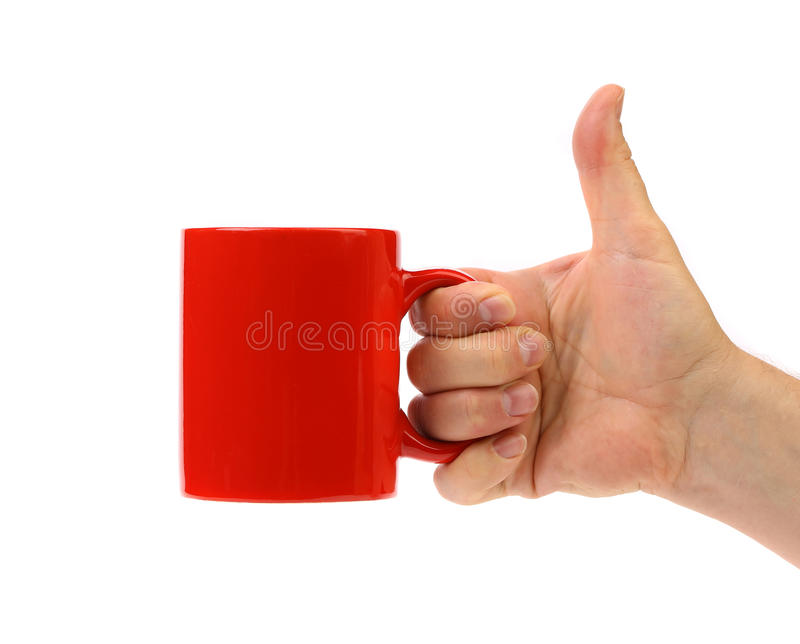 Tasse de rouge de prise de main. images stock