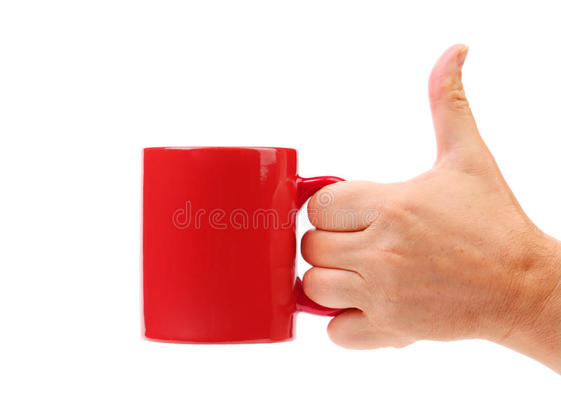 Tasse de rouge de prise de main. photo libre de droits
