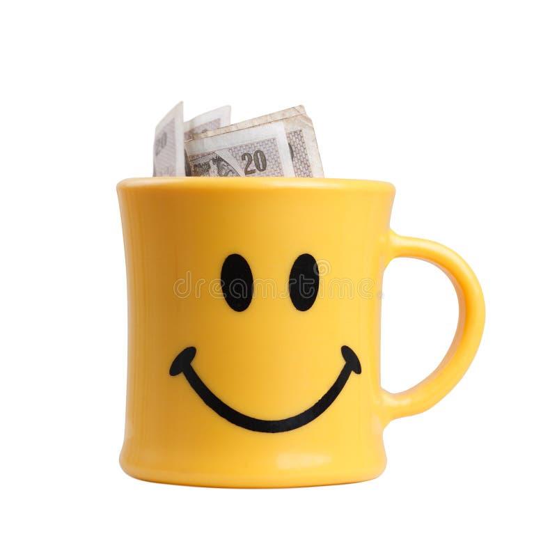 Tasse de sourire avec de l'argent image libre de droits