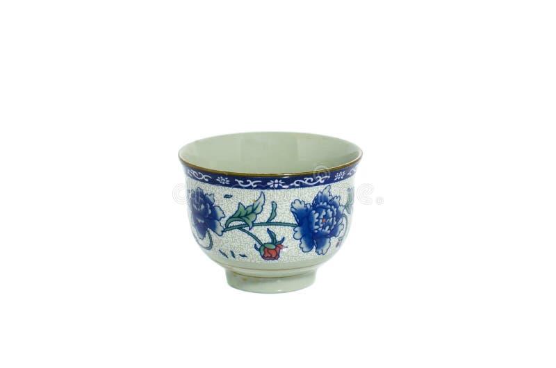Tasse de thé dans l'isolat chainese de style sur le fond blanc photographie stock libre de droits