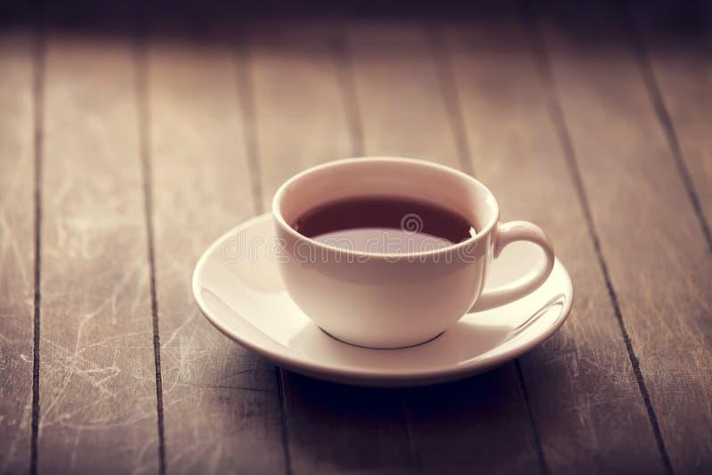 Tasse de thé dans le style de couleur de cru. images stock