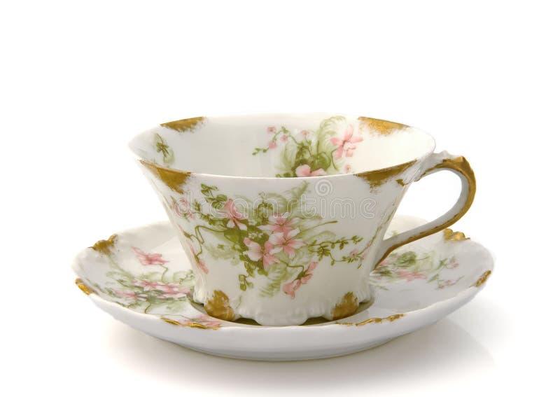 Tasse de thé et soucoupe antiques photos stock