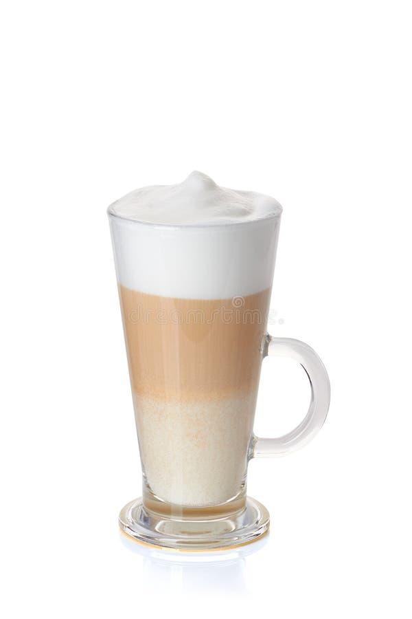 Tasse en verre de latte de café sur le blanc photographie stock
