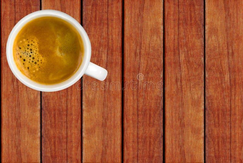 Tasse Kaffee auf Holztisch, Draufsicht stockfoto