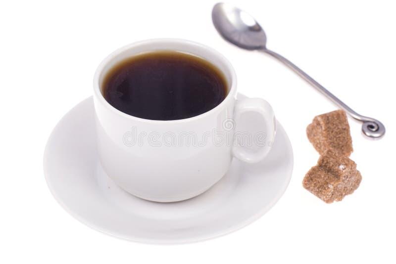 Tasse Kaffee am Bruch im workplac lizenzfreie stockfotografie