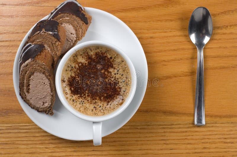Tasse Kaffee mit Nachtisch lizenzfreies stockbild
