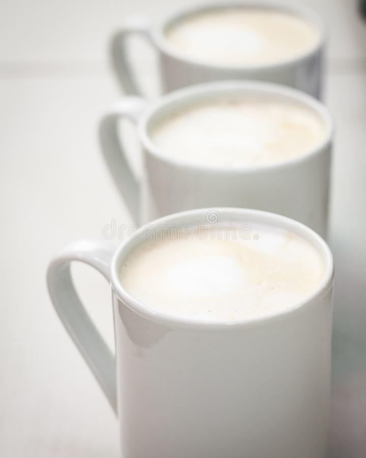 Tasse Kaffee-Reihe lizenzfreies stockfoto