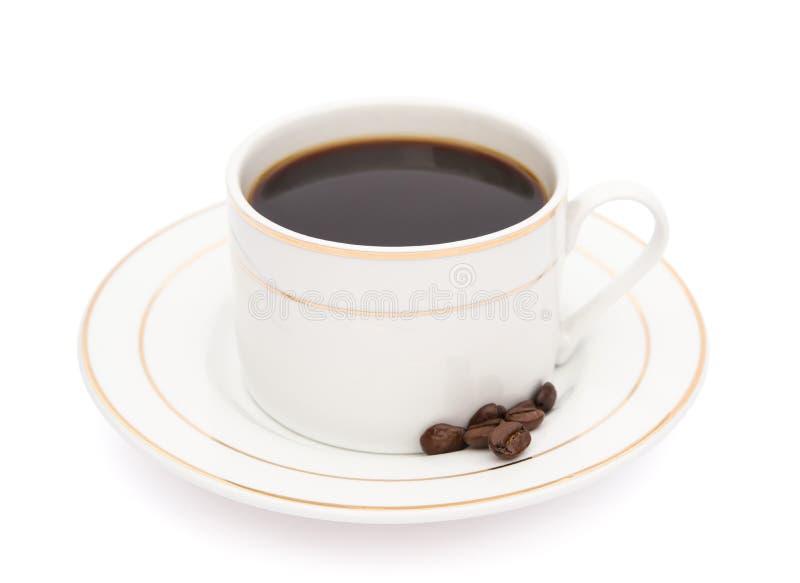 Tasse Kaffee und Kaffeebohne lizenzfreies stockbild