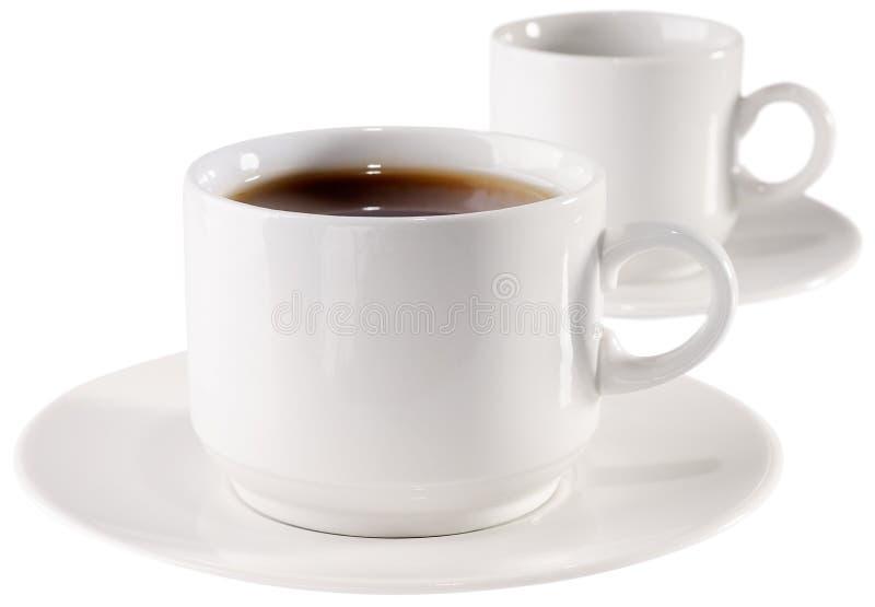 Tasse Kaffee und leeres Cup stockfotos
