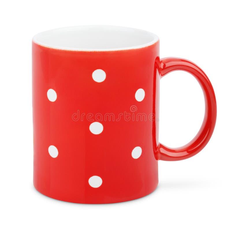Tasse rouge avec le point de polka image libre de droits
