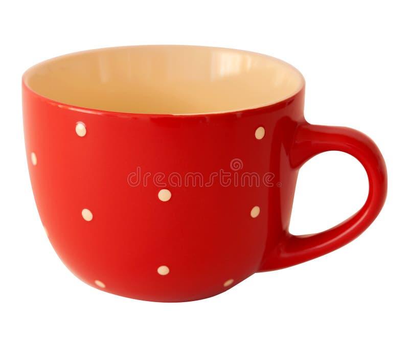 Tasse rouge de point de polka sur un fond blanc images libres de droits