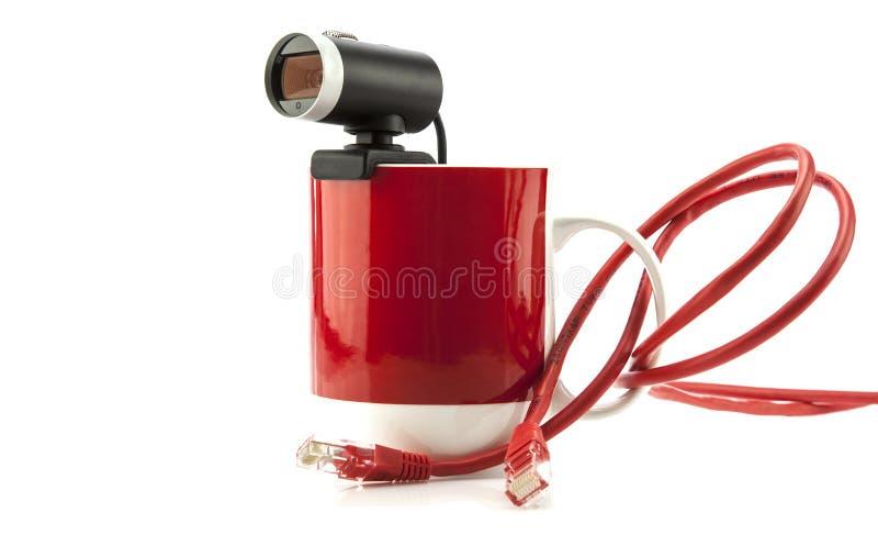 Tasse sociale de concept de réseau avec le webcam photos stock