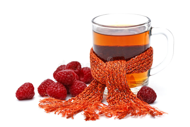 Tasse Tee mit Himbeere lizenzfreies stockfoto