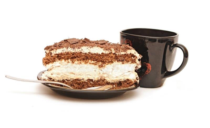 Tasse Tee und Schokoladenkuchen stockbild