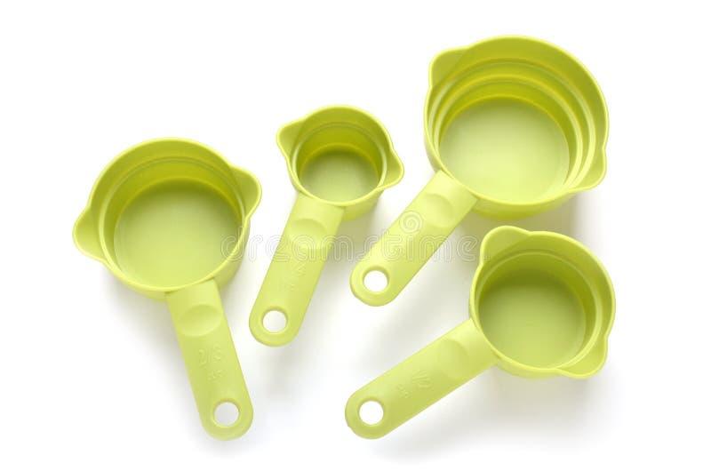 Tasses de mesure en plastique photo stock