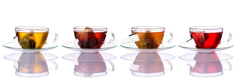 Tasses de thé avec des sacs en collage photographie stock libre de droits
