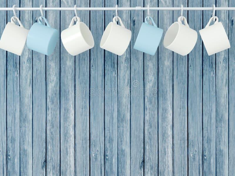 Tasses en céramique sur des crochets illustration libre de droits
