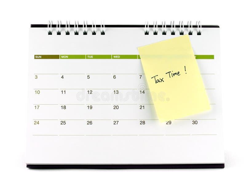 Tassi il tempo scritto sulla nota di carta legata alla pagina del calendario fotografia stock