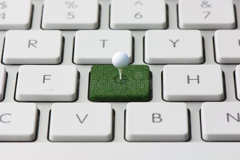Tastatur und Golf lizenzfreie stockbilder