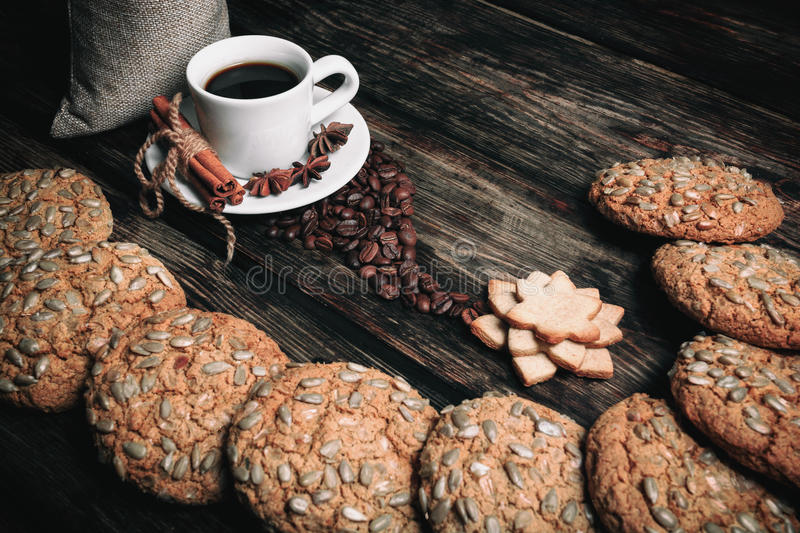 Taste cup of coffee with roasted grains stock photography