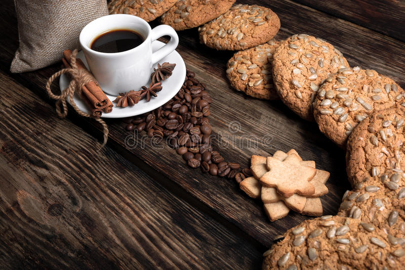 Taste cup of coffee with roasted grains stock photos