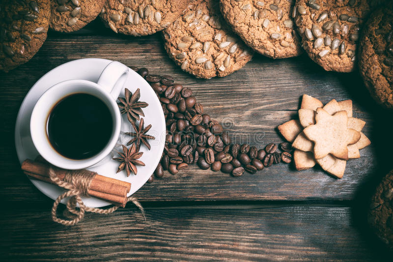 Taste cup of coffee with roasted grains royalty free stock images