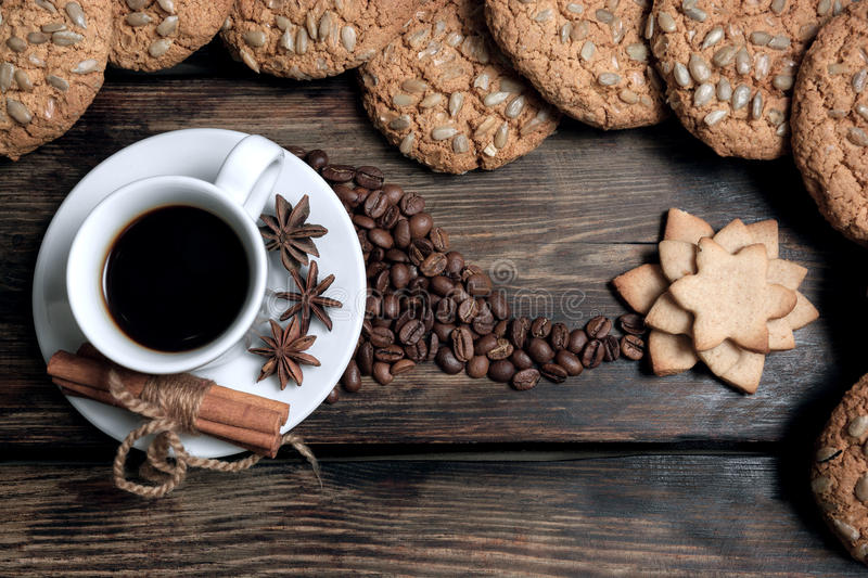 Taste cup of coffee with roasted grains stock images