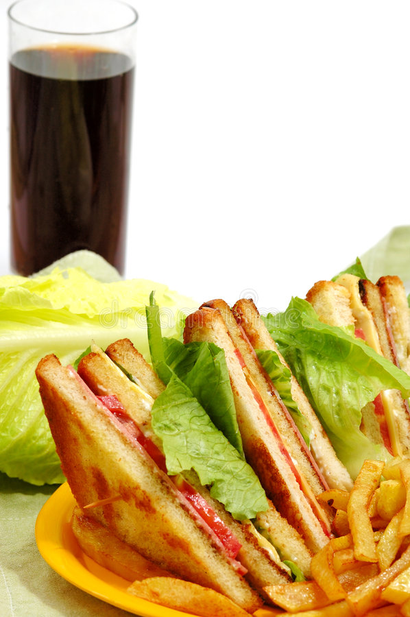 Tasteful club sandwich. And a drink stock photography