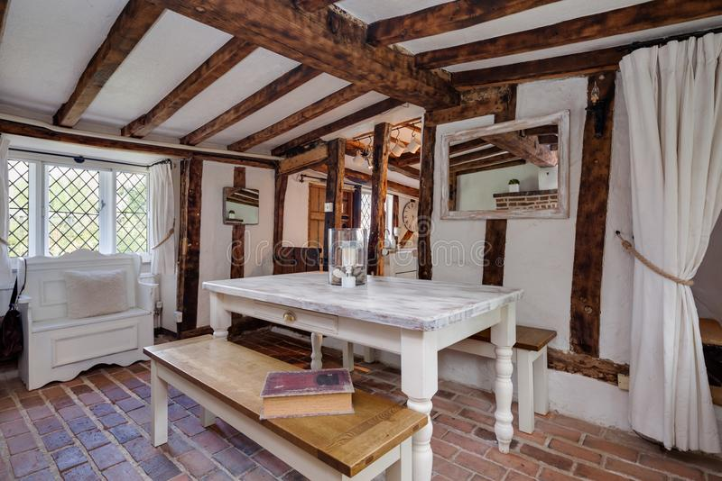 Beautiful 16th Century traditional English cottage dining room. Tastefully modernised and decorated dining room within 16th century english cottage containing stock image