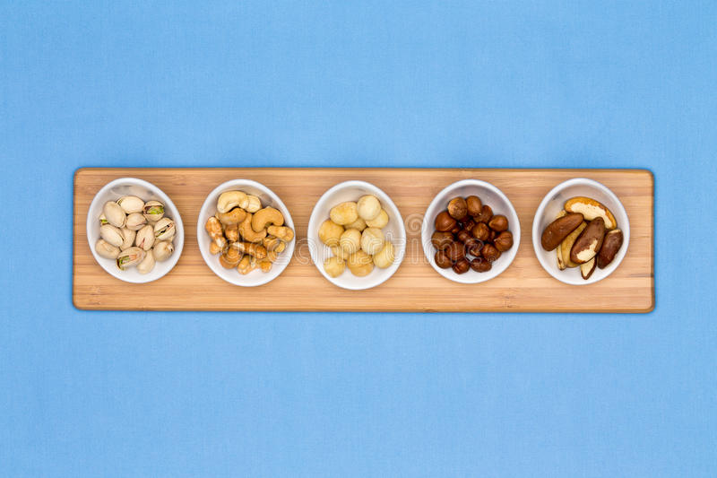 Taster dishes of assorted nuts royalty free stock photo