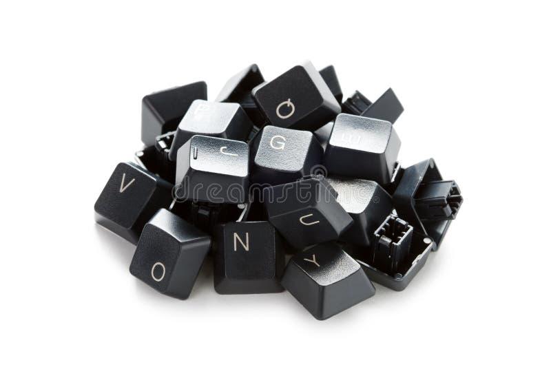 Tasti di calcolatore casuali in un mucchio immagine stock libera da diritti