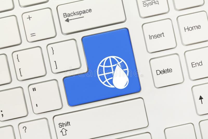 Tastiera concettuale bianca - chiave blu con il simbolo della goccia di acqua e della terra fotografie stock