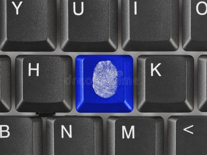 Tastiera di computer con l'impronta digitale immagini stock libere da diritti