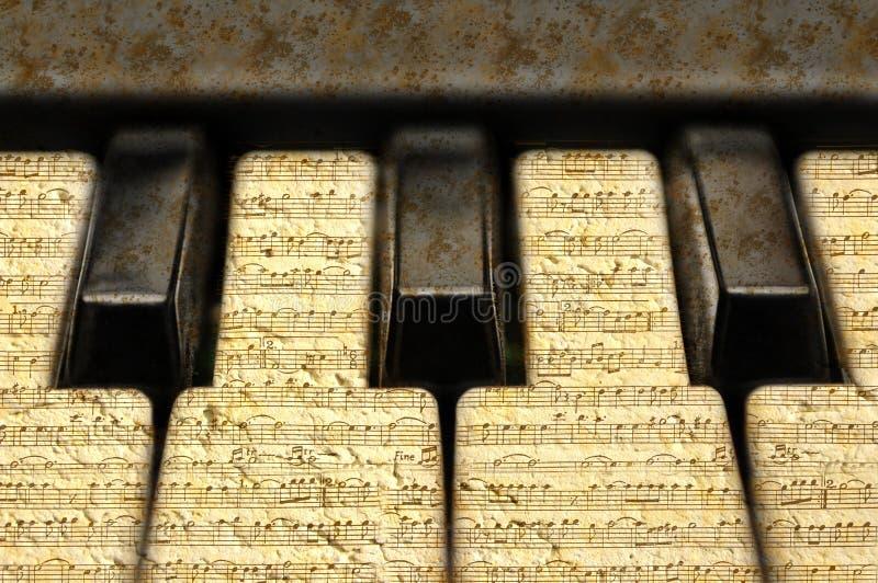 Tastiera di musica con le note di lerciume fotografia stock