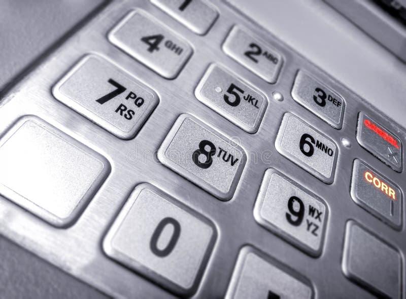 Tastiera numerica metallica dell'input su un Bancomat fotografia stock libera da diritti