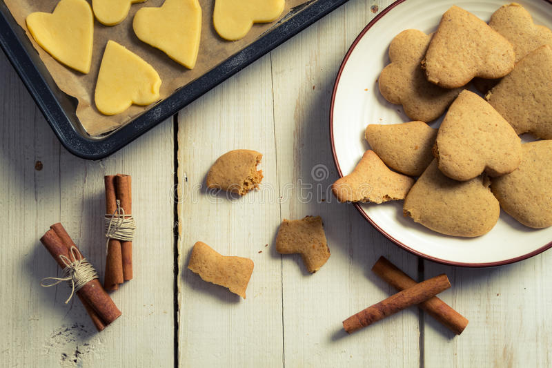 Tasting freshly baked gingerbread cookies for Christmas stock images