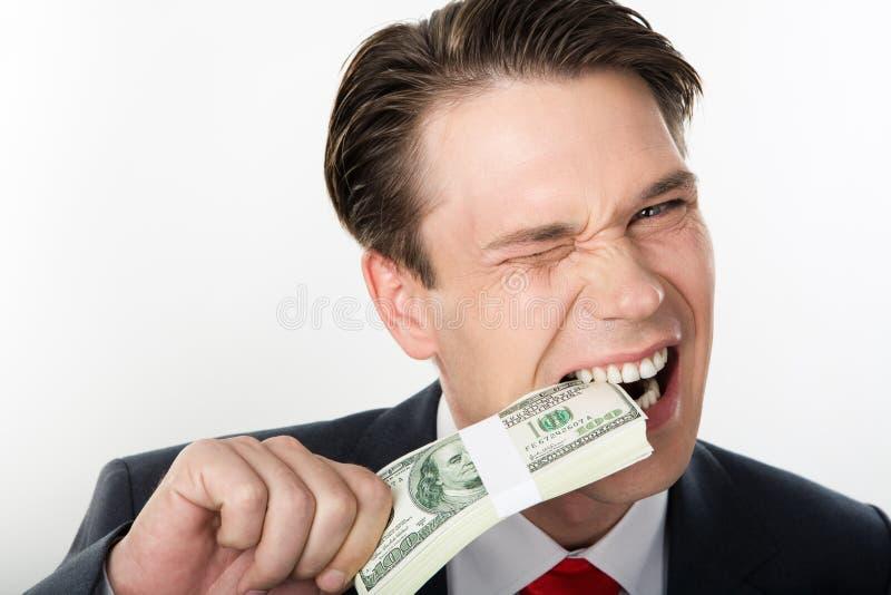 Tasting money stock image