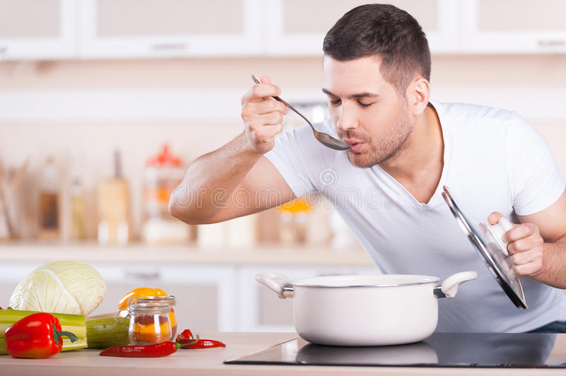 Tasting soup. royalty free stock image